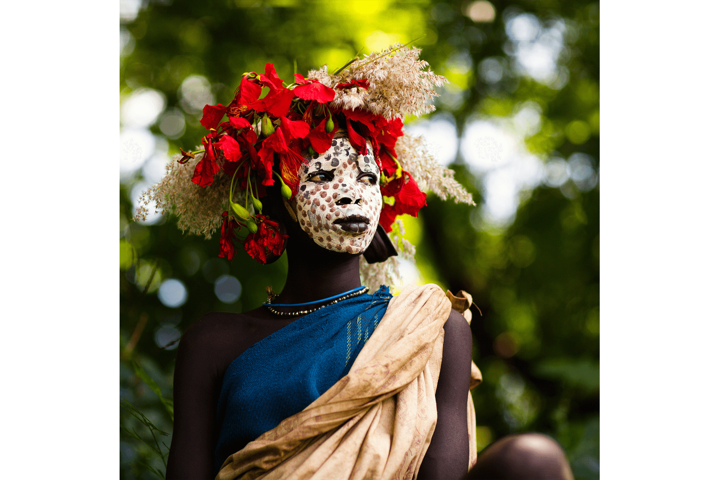 Omo Tribe woman with face paintings and accessories