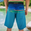 Crest shorts man beach shorts standing in nature by mayamaya